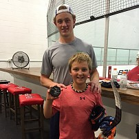 Jack Eichel and Lucas with Jack's signed broken puck