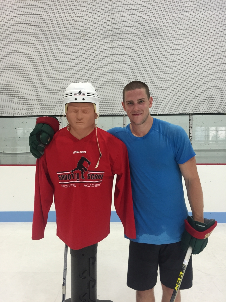 Minnesota Wild's Charlie Coyle with STS Joe Bender